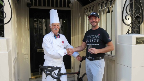 Anton Mosimann and Robert Simpson outside Mosimann's with BMC Bike